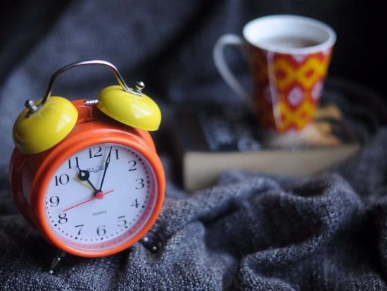 clock and a cup of tea