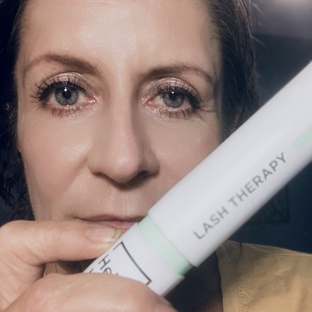 Holding Lash Therapy tube