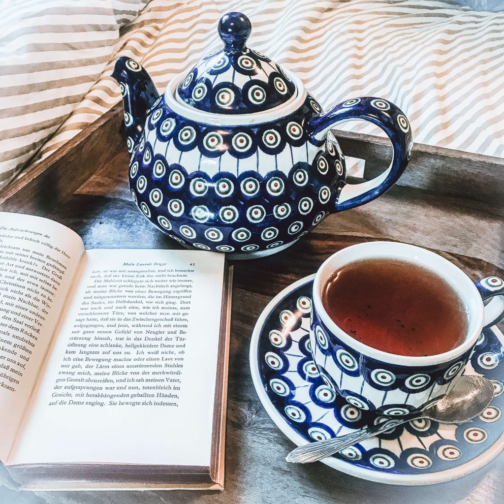 tea pot and cup with book